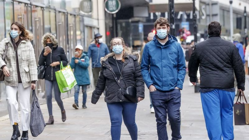 people walking with masks on