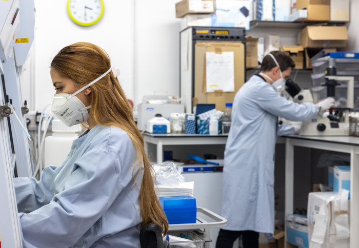 lab workers in masks