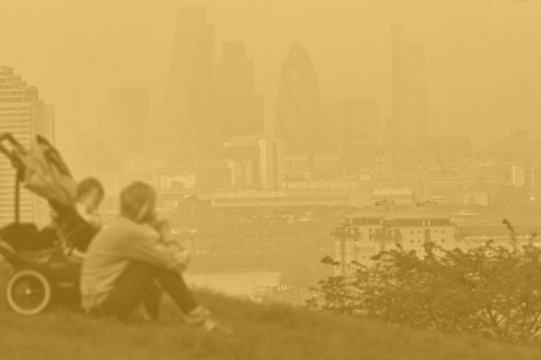 Person overlooking polluted London cityscape