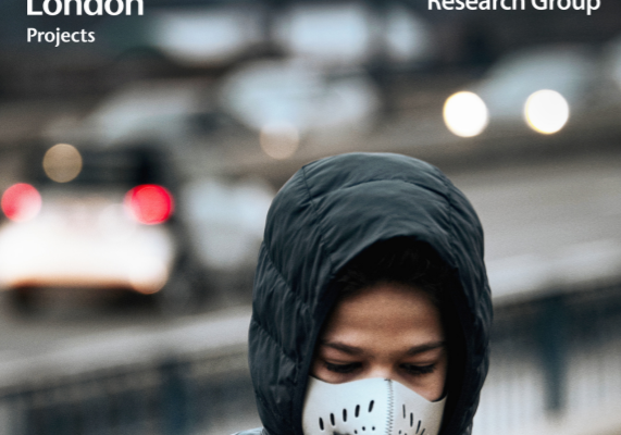 Person in a jacket with a white mask